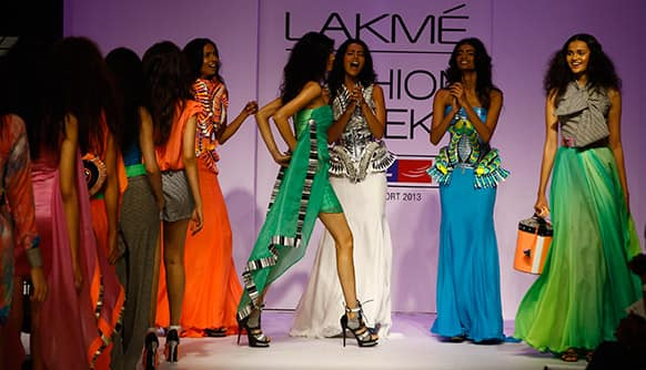 Models display a creation by Swapnil Shinde during the Lakme Fashion Week.