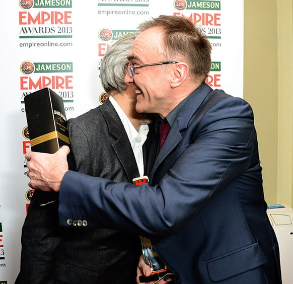 Directors Danny Boyle, right, and Sam Mendes hug at the Jameson Empire Film Awards 2013, at Grosvenor House in London.