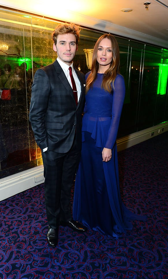 Sam Claflin and Laura Haddock seen at the Jameson Empire Film Awards 2013, Grosvenor House in London.