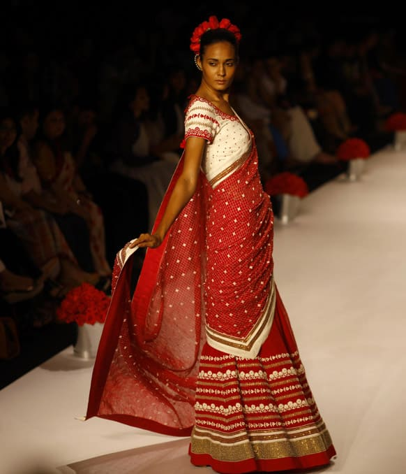 A model displays a creation by Soumitra Mondal during the Lakme Fashion Week in Mumbai.