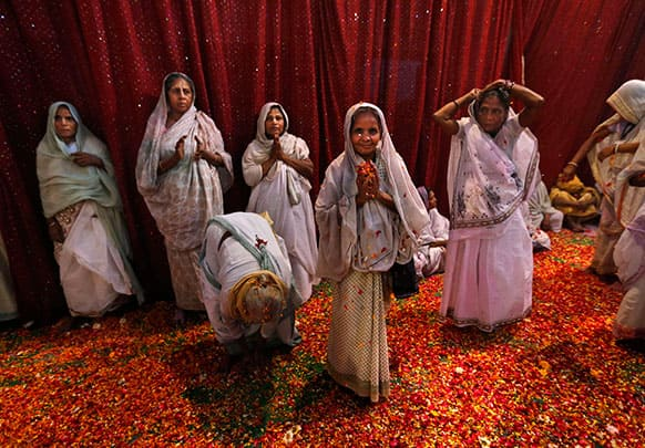 Indian widows pray during Holi celebrations, or the festival of colors, at an event organized by the NGO Sulabh at the Meera Sahbhagini Ashram in Vrindavan.