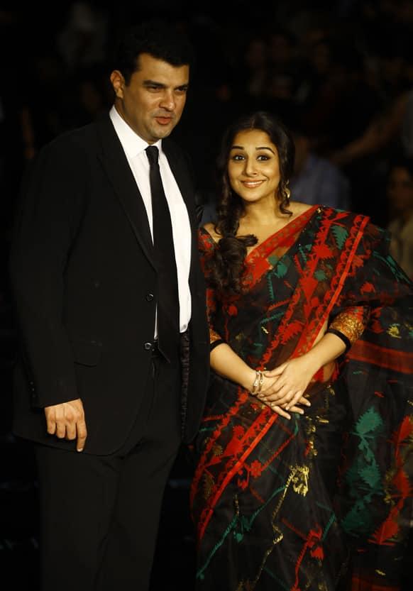 Bollywood actress Vidya Balan attends the Lakme Fashion Week with her husband Siddharth Roy Kapur in Mumbai.