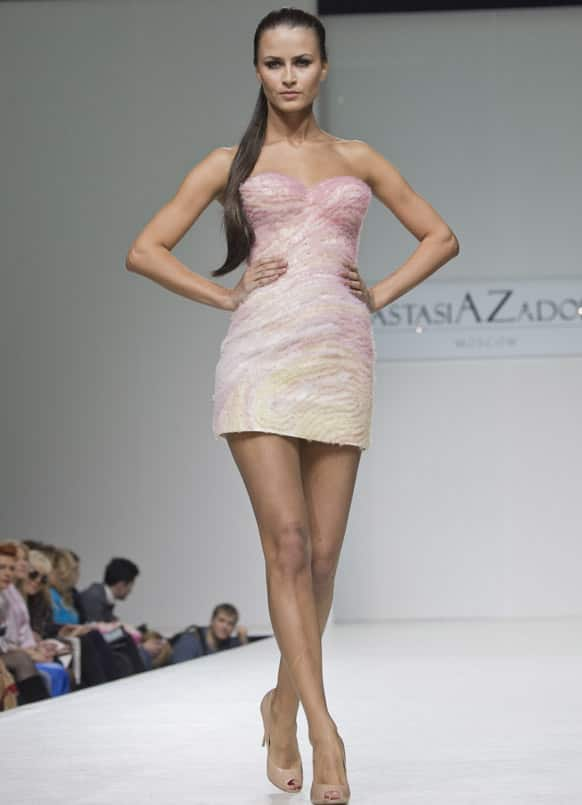 A model displays a creation by Anastasia Zadorina during Moscow Fashion Week, Russia.