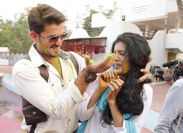 Neil Nitin Mukesh and Tena Desai play Holi on the sets of 'Dussehra'.