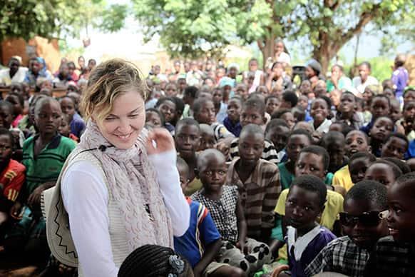 Singer Madonna visiting school children in Chorwe, Malawi.