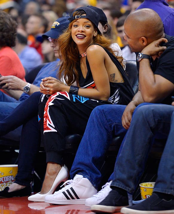 Singer Rihanna watches the Los Angeles Clippers play the Los Angeles Lakers in their NBA basketball game.