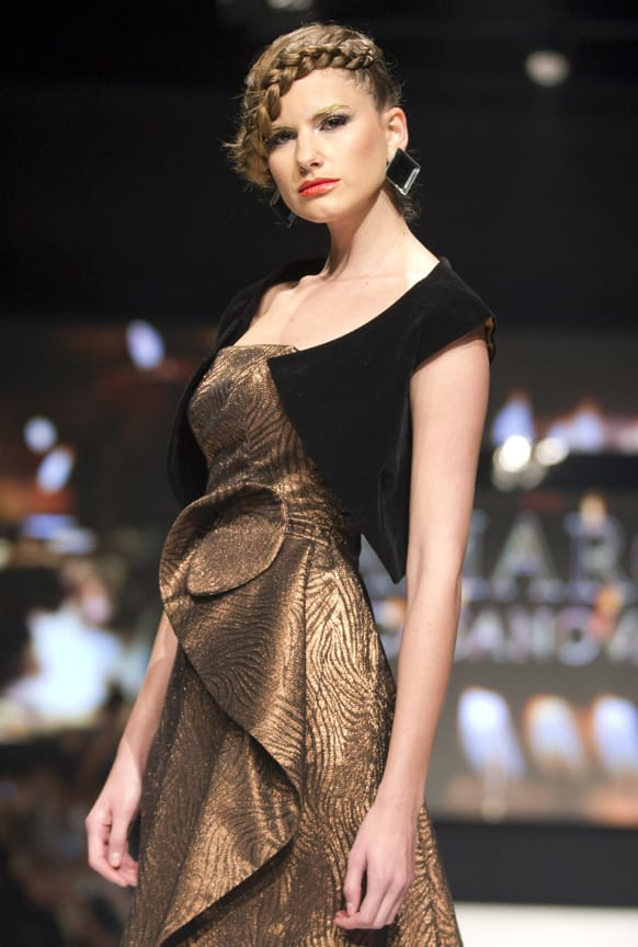 A model wears a creation by Peru's Amaro Casanova during Lima Fashion Week in Lima, Peru.