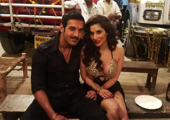 John Abraham and Sophie Choudry pose for a click on the sets of 'Shootout At Wadala'.