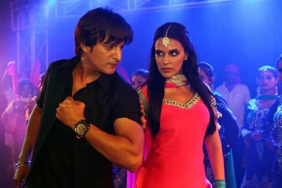 Jimmy Sheirgill and Neha Dhupia in a still from Punjabi film 'Rangeelay'