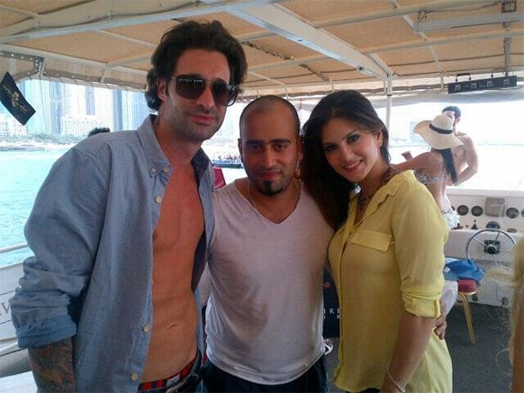 Sunny Leone poses for the camera with her husband Daniel Weber (left) and a friend.