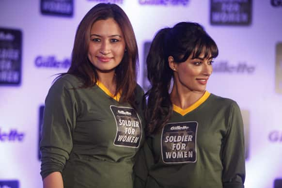 Badminton player Jwala Gutta and Bollywood actor Chitrangada Singh pose for the media during a promotional event for