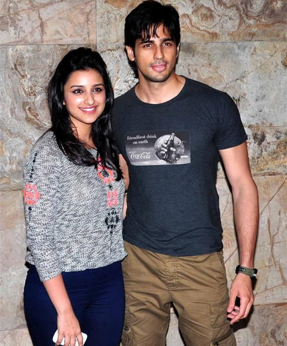 Parineeti Chopra and Sidharth Malhotra pose for the shutterbugs at the recently held screening of 'Bombay Talkies'.