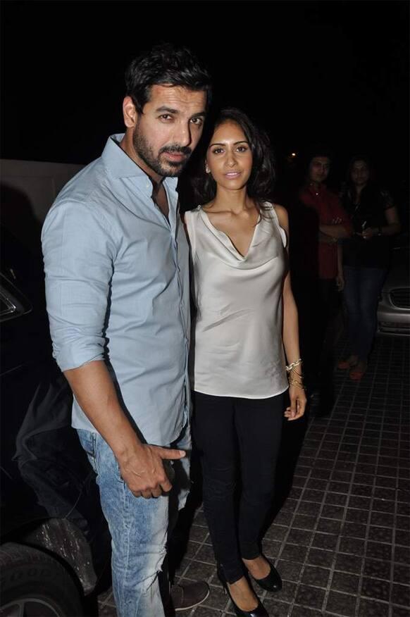 John Abraham and Priya Runchal pose for a photograph after a screening of 'Shootout At Wadala'. The film hits theatres May 3, 2013.
