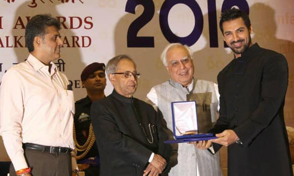 John Abraham receives the award for 'Vicky Donor'. The film, directed by Shoojit Sircar, won three awards - Supporting Actor, Supporting Actress and Film Providing Wholesome Entertainment.