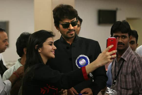 A girl gets a photograph taken with Irfan Khan during the National Film Awards 2012, in New Delhi. Khan was awarded the Best Actor.