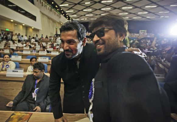 John Abraham hugs fellow actor Irfan Khan during the National Film Awards 2012, in New Delhi. Abraham's debut production