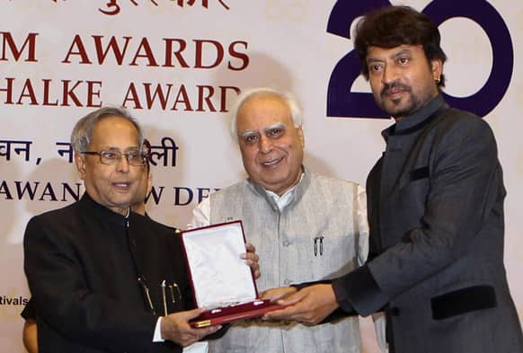 Irfan Khan receives the Best Actor award from President Pranab Mukherjee during the National Film Awards 2012, in New Delhi.