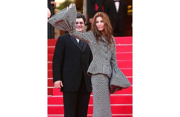 Catherine Keener just fails to impress us in this 1970's style chequered dress, with bell sleeves.