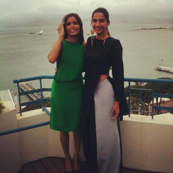 Freida Pinto and Sonam Kapoor pose for a picture at Hotel Martinez in Cannes.