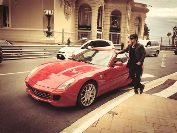 Ali Zafar poses with a Ferrari.