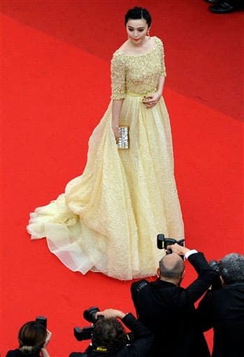 Actress Fan Bingbing scored full marks for the shimmery yellowish evening dress she wore on Day 2 of Cannes 2013.