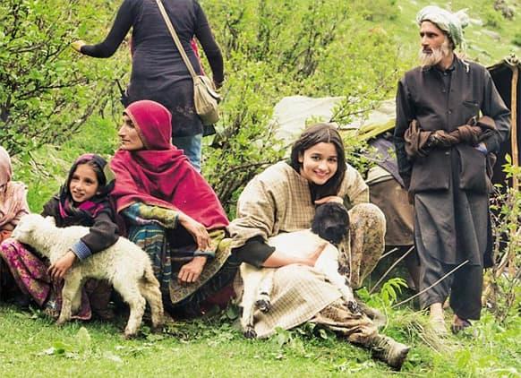 A cute Alia Bhatt poses for the lenses on the sets of 'Highway' in Kashmir. Directed by Imtiaz Ali, the film stars Randeep Hooda across Alia.
