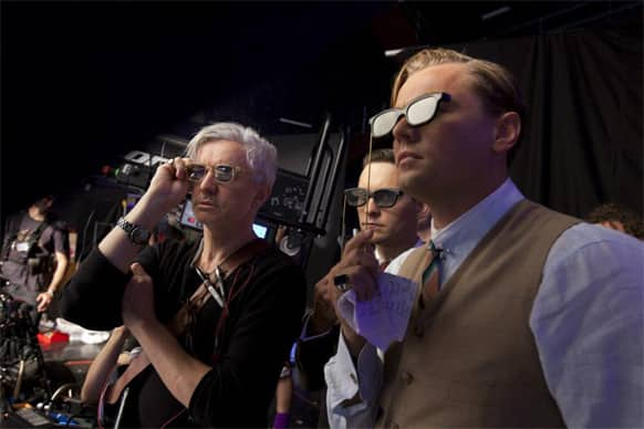 Director Baz Luhrman, Tobey McGuire and Leonardo DiCaprio catch a glimpse of 'The Great Gatsby' through their 3-D glasses. The film released May 17.