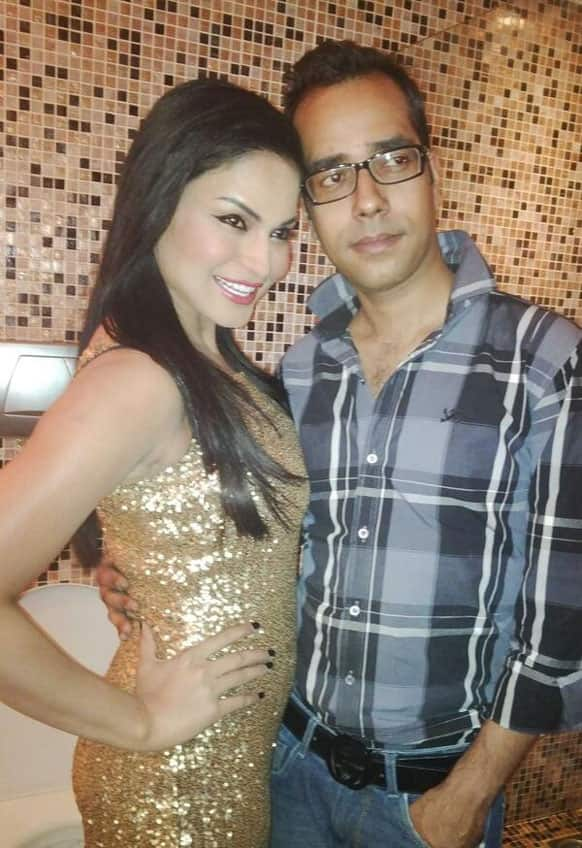 Veena Malik poses with her very dear designer friend Ashfaque Ahmad. She is wearing the dress designed by him.