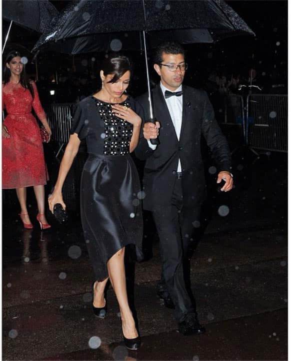 Freida Pinto is seen in thic picture at the after party of 'The Great Gatsby' in Cannes. There is Sonam Kapoor too walking behind her.