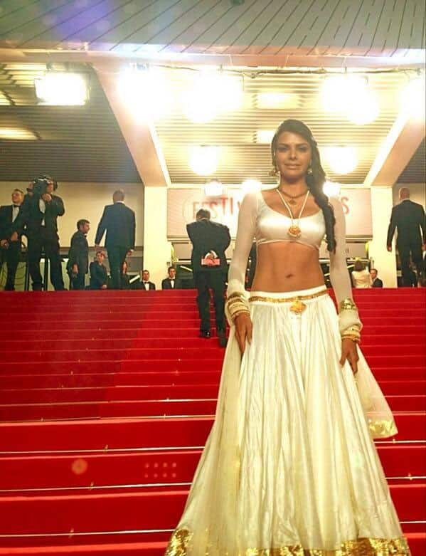 Sherlyn Chopra wore a white and gold ghagra-choli at the premiere of 'La Grande Bellezza' at the Cannes Film Festival. She even shimmied with the press.