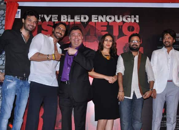 The 'D-Day' team pose for a photograph at the launch of the film's first look.