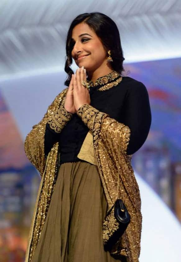 Vidya Balan greets the crowd with a traditional 'namaste' on the closing day of the Cannes 2013 film fest.