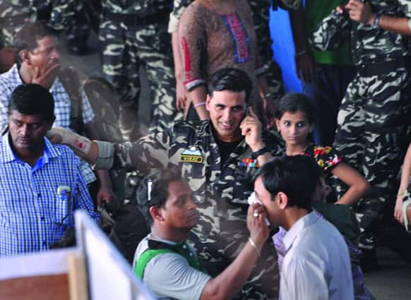 Akshay Kumar shooting at a railway station. The film in question could be 'Once Upon a Time in Mumbaai Again'.