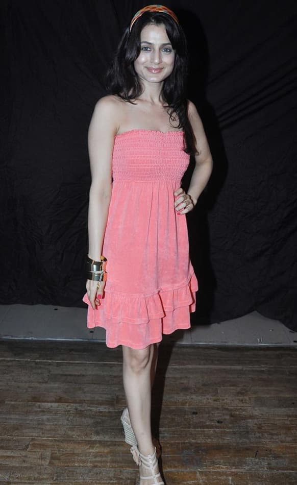 Ameesha Patel poses for a photograph at a promotional event for 'Shortcut Romeo'.