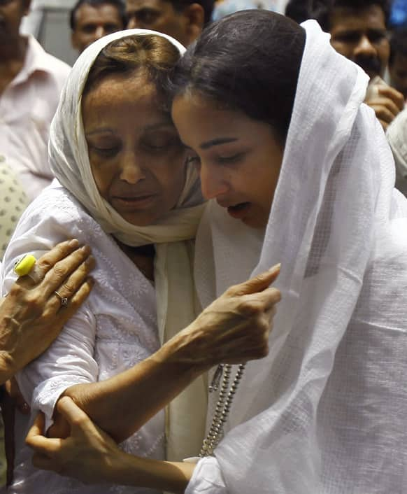 Relatives of Bollywood actress Jiah Khan mourn during her funeral in Mumbai.