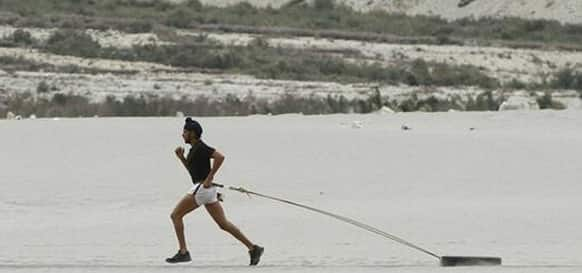 Farhan Akhtar in a still from 'Bhaag Milkha Bhaag'.