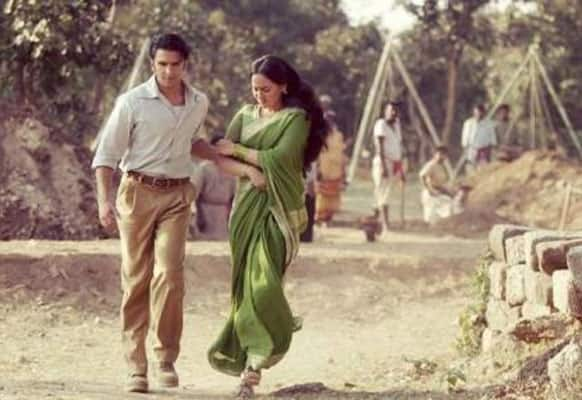 Sonakshi is being forcibly escorted by Ranveer in this still from 'Lootera'.