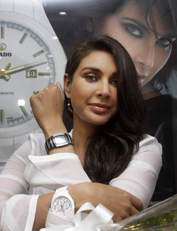 Lisa Ray poses with a diamond studded watch from Swiss watch maker Rado in Kolkata. The watch is from a new collection and the price range starts from $3800 approximately.