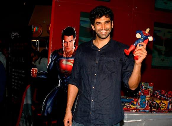 Aditya Roy Kapur poses with a Superman miniature.