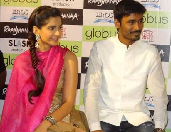 Sonam and Dhanush address the media during a promotion event in Gujrat's capital.