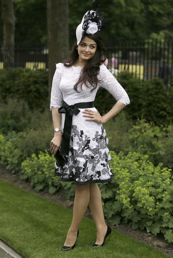 Bollywood actress Aishwarya Rai Bachchan poses for the media on the first day the Royal Ascot horse race meeting in Ascot, England.