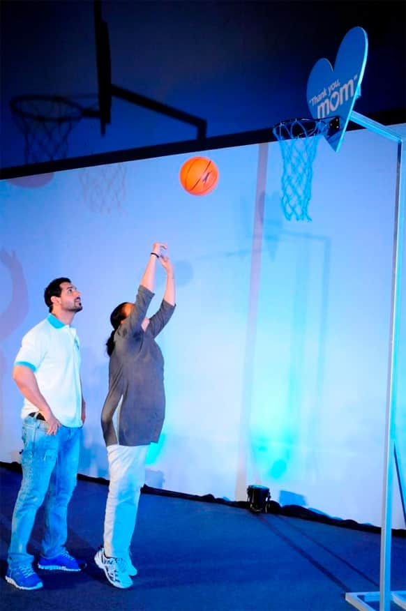 John Abraham looks on as his mother scores a basket - at the 'Thank You mom' initiative by P&G.