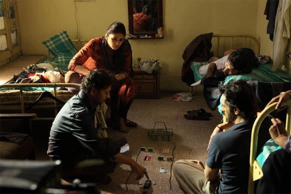 Huma Qureshi, Irrfan Khan, Arjun Rampal and Sandeep Kulkarni in a still from 'D-Day'.