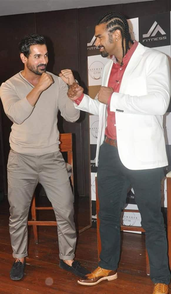John Abraham in a friendly boxing pose with renowned boxer David Haye.