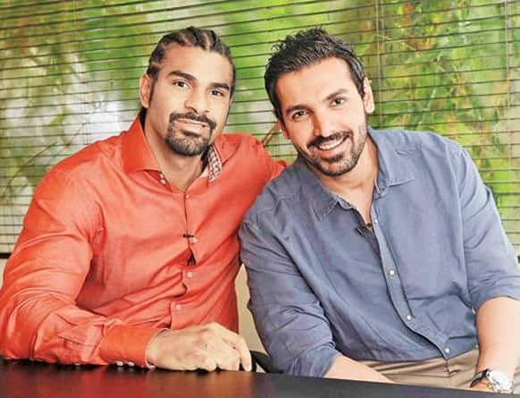 John Abraham poses for a photograph with renowned boxer David Haye.