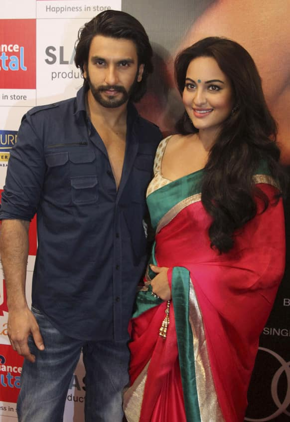 Sonakshi Sinha and Ranveer Singh pose for photographs during a press conference to promote their upcoming movie Lootera in Ahmadabad.