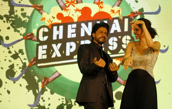 Shah Rukh Khan dances with co actor Deepika Padukone during the music release for his upcoming movie