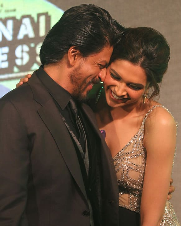 Shah Rukh Khan shares light moment with co actor Deepika Padukone during the music release his upcoming movie