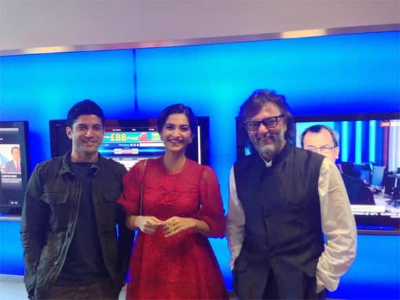 Farhan Akhtar, Sonam Kapoor and Rakeysh Omprakash Mehra pose for a photograph during the London promotions of 'Bhaag Milkha Bhaag'.