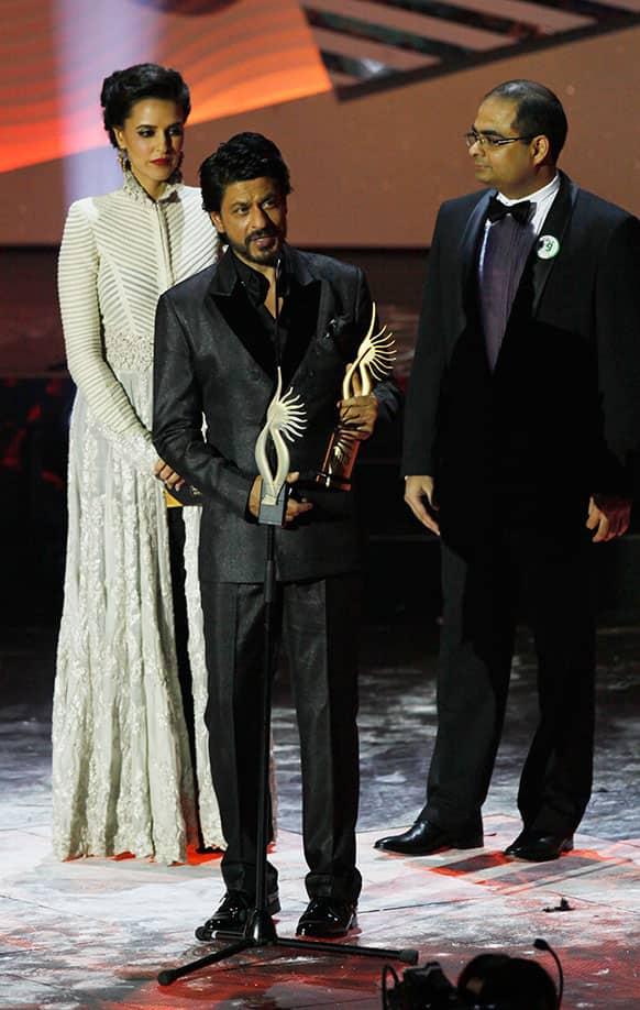 Bollywood actor Shah Rukh Khan receives the Digital Star of the Year award during the International Indian Film Academy (IIFA) awards in Macau.